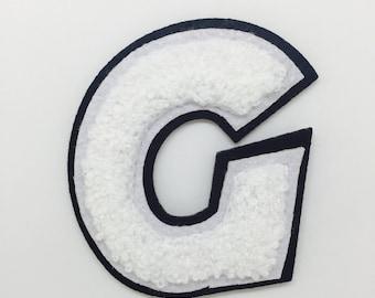 G Varsity letter