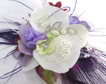 Radiant Orchid Wrist Corsage in Off White, Lavender, Violet with Purple Peacock Feathers