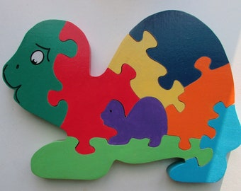 colourful puzzle wooden turtle pattern and her cub