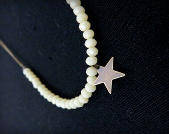 Asymmetrical necklace star brass beads and faceted ivory