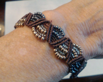 Brown bracelet with gray and gold beads