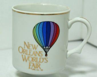 New Orleans Worlds Fair Cup Footed Mug 1983 Hot Air Balloon Gold Trim