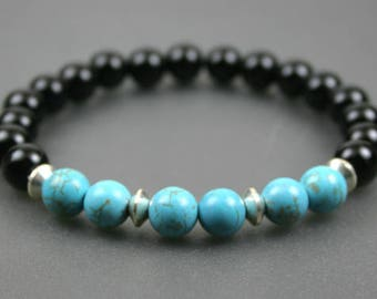 Turquoise magnesite, black onyx, and silver plated roundel stacking stretch bracelet