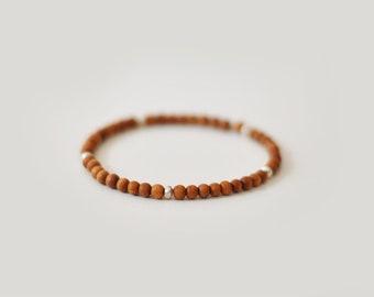 Sandalwood beaded stretch bracelet with thai silver beads
