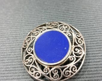 Sterling silver vintage brooch with deep blue stone