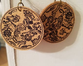 Leather earrings with paisley floral print.