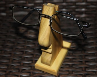 Eye Glass Holder: sturdy, solid wood, glasses sit nicely on the nose. Always know where your glasses are.  Can be finished in any color.
