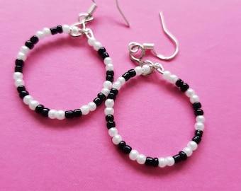 Black and white hoop earings.
