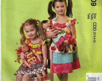 McCall's Patterns M7109Children's  Dress and Doll's Dress Size2-5   Uncut Factory Folded