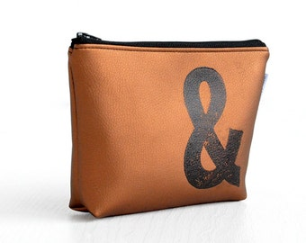 makeup bag in BRONZE stamped with monogram vegan leather, by renna deluxe