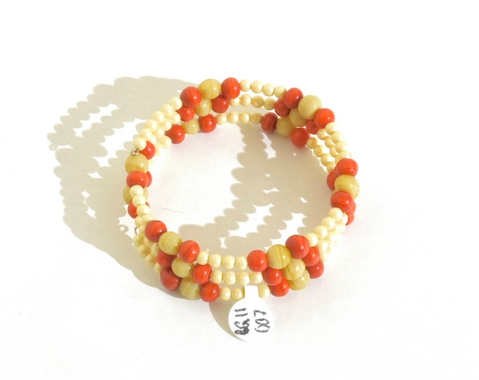 Red Orange, Cream and Off-White Beaded Wrap-Around Bangle- crafted by Nepalese human trafficking victims