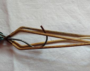 Old metal foldable hanger. Vintage. Rustic Decor Old.