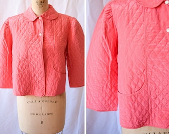 Linnux | Vintage 1950s Bed Jacket Quilted Salmon Pink Nylon Peter Pan Collar and Front Pockets 50s Bedjacket Short Robe Bust 36-38
