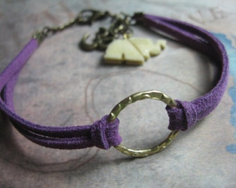 Om bracelet with a mix of suede cording and metals with om and elephant charms