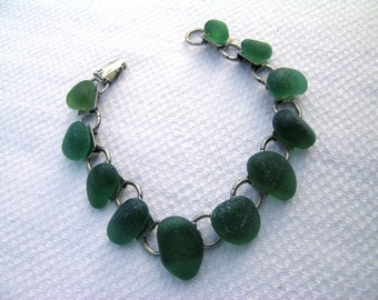 Stunning upcycled beachcombed graduated deep green sea glass beach glass nuggets on a hand crafted vintage 1970s silver tone metal bracelet