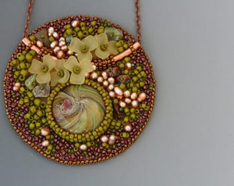 Bead embroidered pendant on a delicate copper chain necklace. Green and brown necklace. Floral theme. Glass, resin, pearls, ultrasuede.