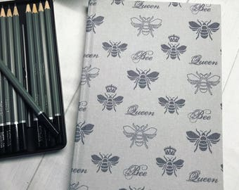 Grey queen bee design fabric covered artist sketch book. A5 128pages