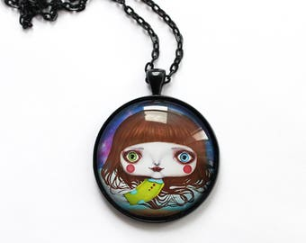 Necklace with print of space girl, art by Susann Brox Nilsen. Lowbrow, pop art, cartoon, comics, space, universe, galaxy, stars, water, sea.
