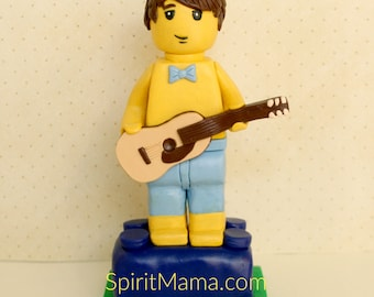 Yellow Block Man With Guitar in Swim Trunks