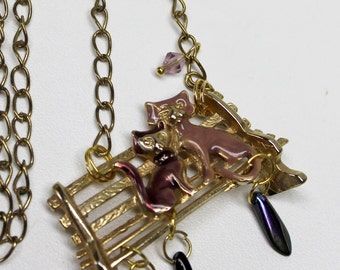 vintage purple cat duo enameled brooch turned into a brooch,cat necklace,cats sitting on a bench,recycling a brooch,cat brooch,