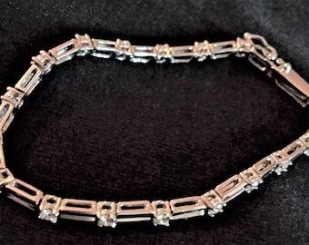 14K White Gold Line Bracelet featuring 1.70 carats of Round Brilliant Diamonds