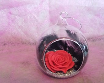 Decorative rose on a bed of feathers