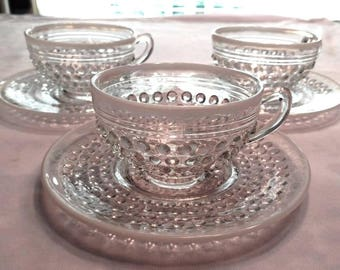 White Opalescent Cups and Saucers in the Moonstone Pattern by Anchor Hocking
