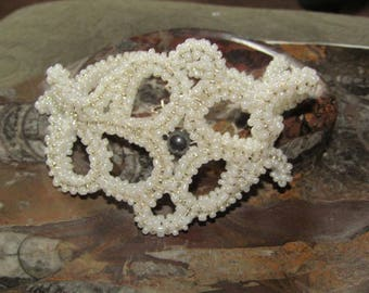 White cubic right angle weave bracelet