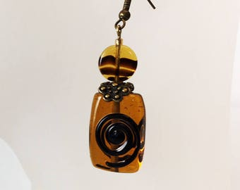 Earrings black ribbed amber glass beads