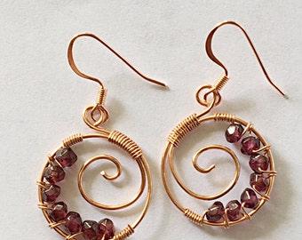Circular Swirl Earring: Copper and Garnet