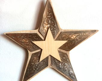 Recycled etched metal and plywood star.