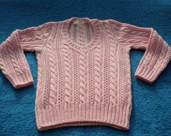 Bright pink sweater knitting fashion with lace and braids