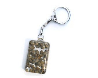 Key ring with real dried cannabis seeds. Resin keychain.