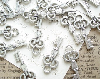 Skeleton Key Charms. 12 Antiqued Silver Vintage Style Small Key Stampings. Steampunk, Jewelry, Scrapbooking, Crafts, Destash Supplies Sale.