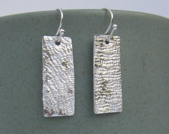 Silvery aluminum light weight rectangle textured earrings