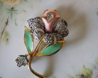 Sparkly brooch with lots of rhinestones and an enameled pink flower!
