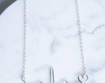 Heartbeat (EKG) necklace.