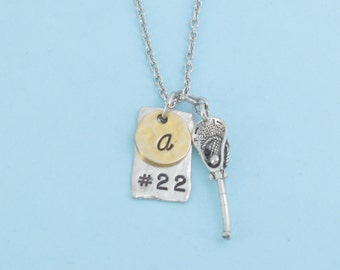 Lacrosse charm pendant in silver pewter personalized by player's number on silver pewter blank and initial in hammered, gold plated pewter.