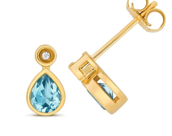 9ct Gold Diamond & Pear Cut 5x4mm Swiss Blue Topaz Stud Earrings