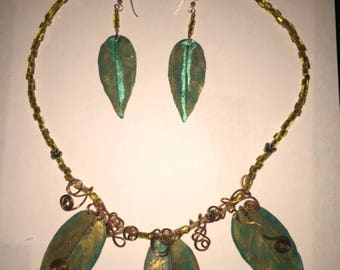 Handmade copper wire wrapped leaf necklace and earrings with sterling silver ear wires.
