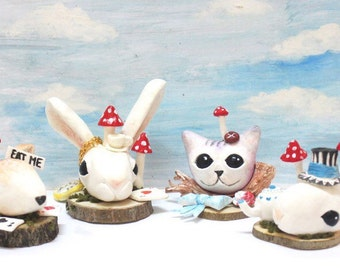 Alice in Wonderland inspired white rabbit deer mouse and cheshire cat sculptures