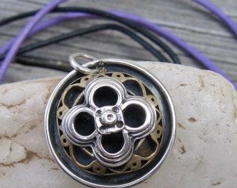 Florentine four petal pendant in silver and bronze Ornamental metalwork pendant