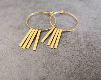 The thin gold rings earrings