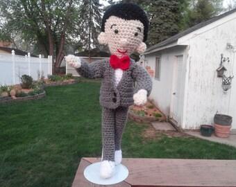 A crochet Pee Wee Herman doll