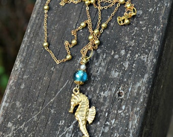 Golden Seahorse Necklace with blue glass beads faux pearl and rhinestone charm on long golden beaded chain handmade gift