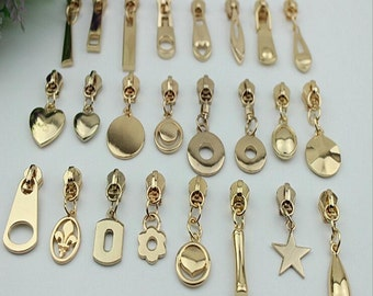 5# 10pcs  light golden  metal head zipper  slider with 25 design puller , zipper slider whole sale . handbag hardware, bag supply