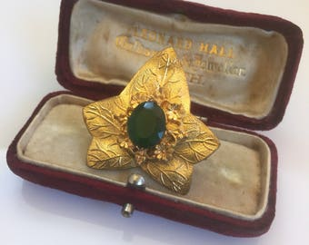 Art nouveau antique gilt metal ivy leaf and daisy vintage green stone gold pin or brooch
