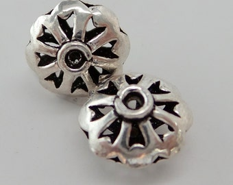 Bali handcrafted 925 sterling silver cut out lace like lentil shaped open beads. Wholesale prices. B135