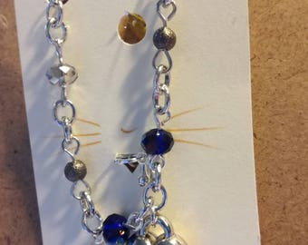 Bracelet with blue iris and transparent faceted beads and pendant at heart