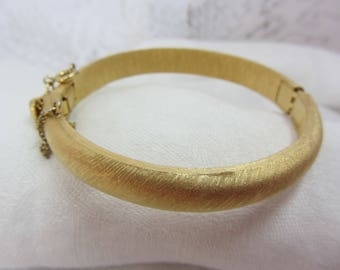 Crown Trifari Brushed Gold Tone Hinge Bangle with Hidden Clasp and Safety Chain